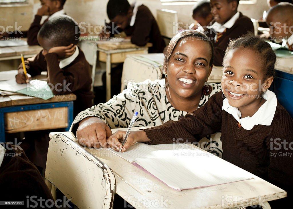 African Schoolgirl and her Teacher stock photo