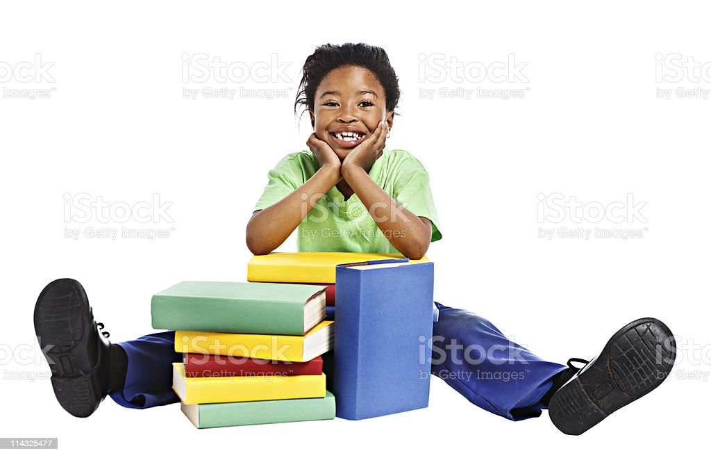 African schoolgirl with stack of books | Lots to learn royalty-free stock photo
