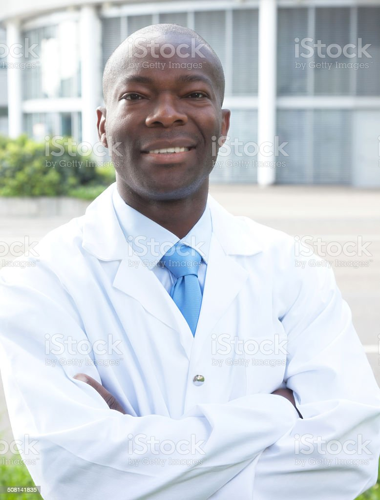 African scientist laughing at camera stock photo