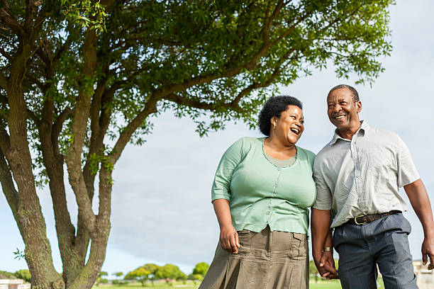 African senior couple laughing, enjoying each others company stock photo