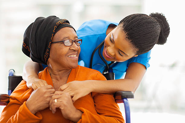 african senior patient with female nurse - elderly patients stock photos and pictures