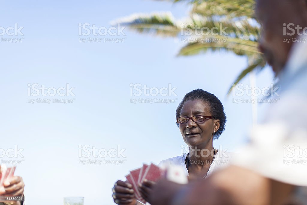 African senior playing a game of cards royalty-free stock photo