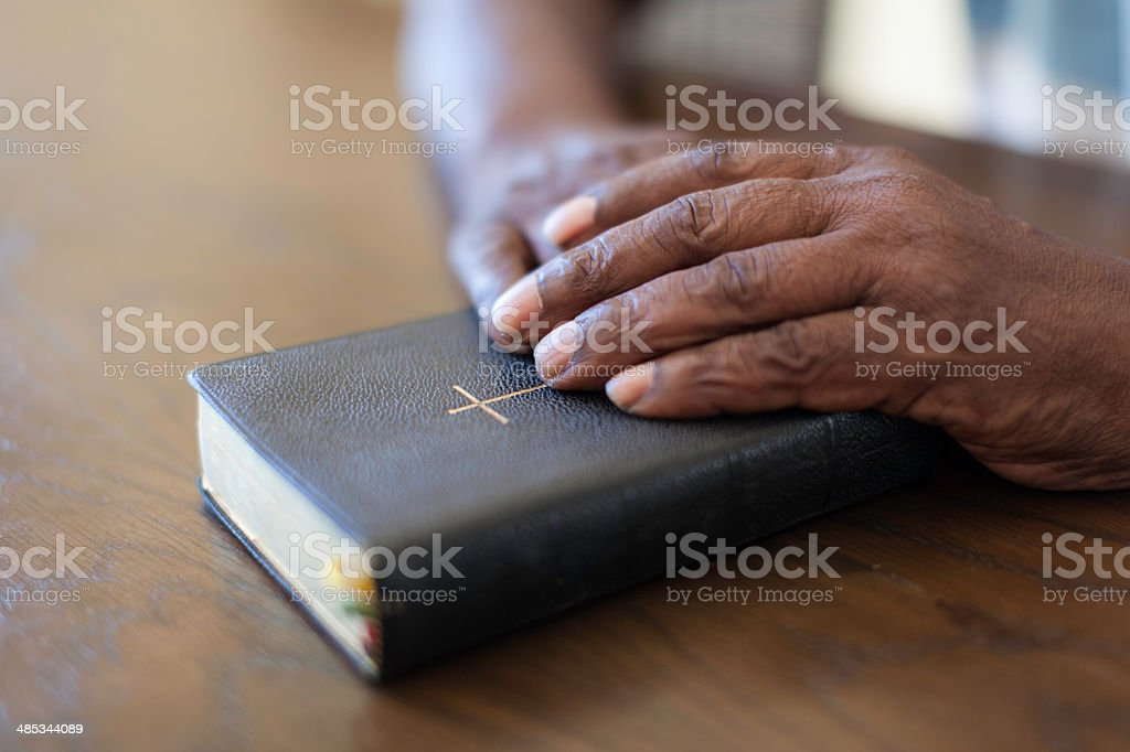 African senior preparing himself to read the bible stock photo