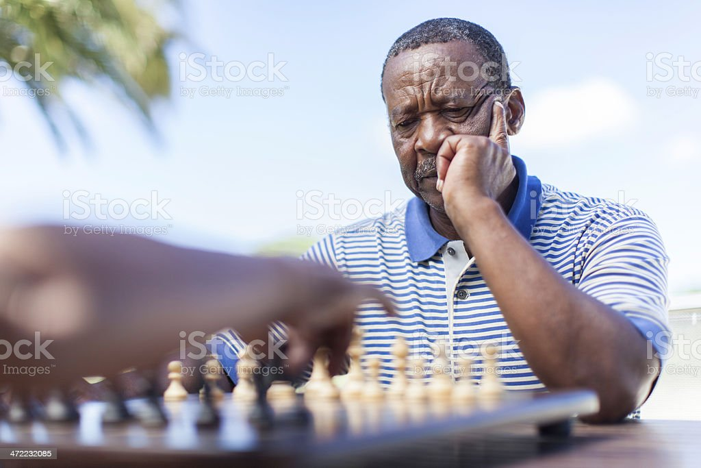 African senior thinking about his next move royalty-free stock photo