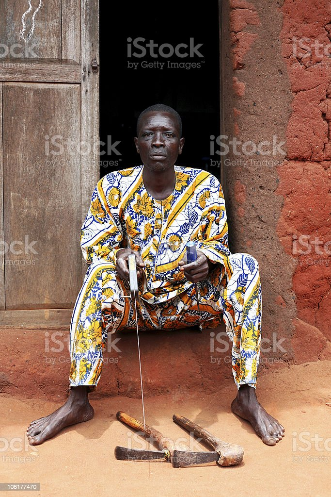 african senior with tools stock photo