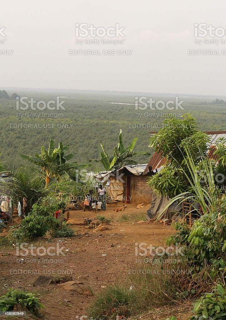 African Shacks Overlooking Rainforest stock photo