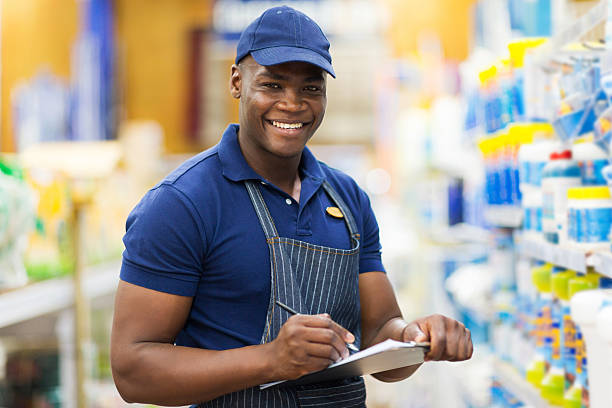 african shop assistant check stock stock photo