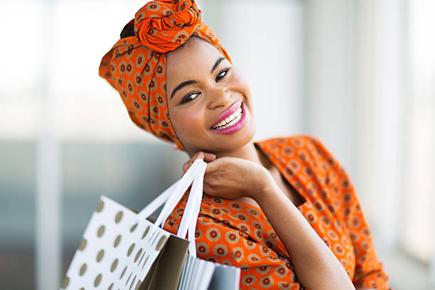 african shopper in shopping mall stock photo