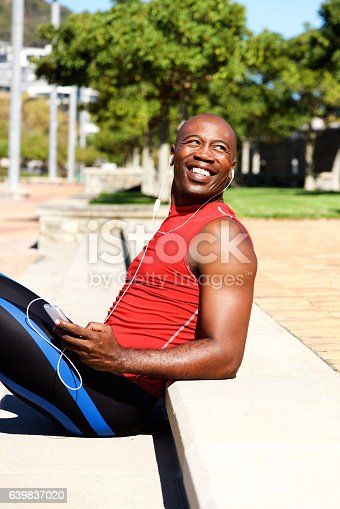 istock African sports man relaxing outdoors and listening to music 639837020