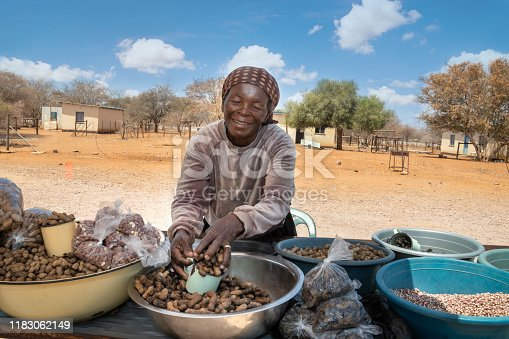 African street vendors on the road selling raw peanuts, corn, monkey oranges and mopane worms,