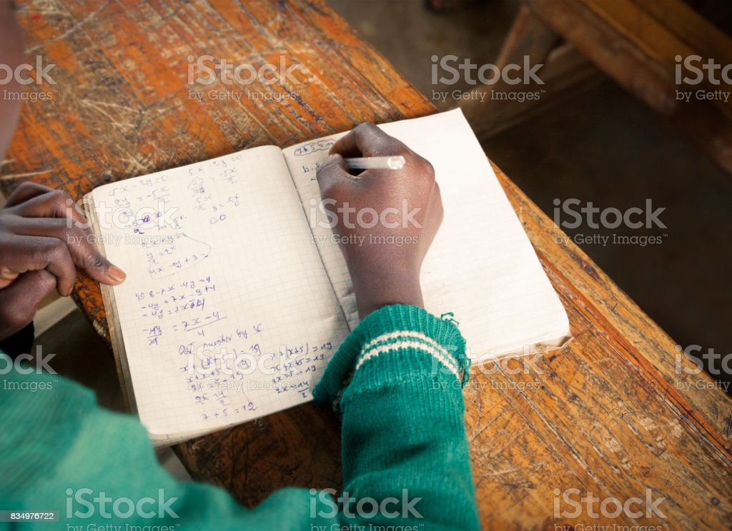 African student at school solving a math problem stock photo