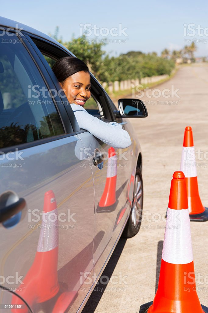 african student driver taking lessons stock photo