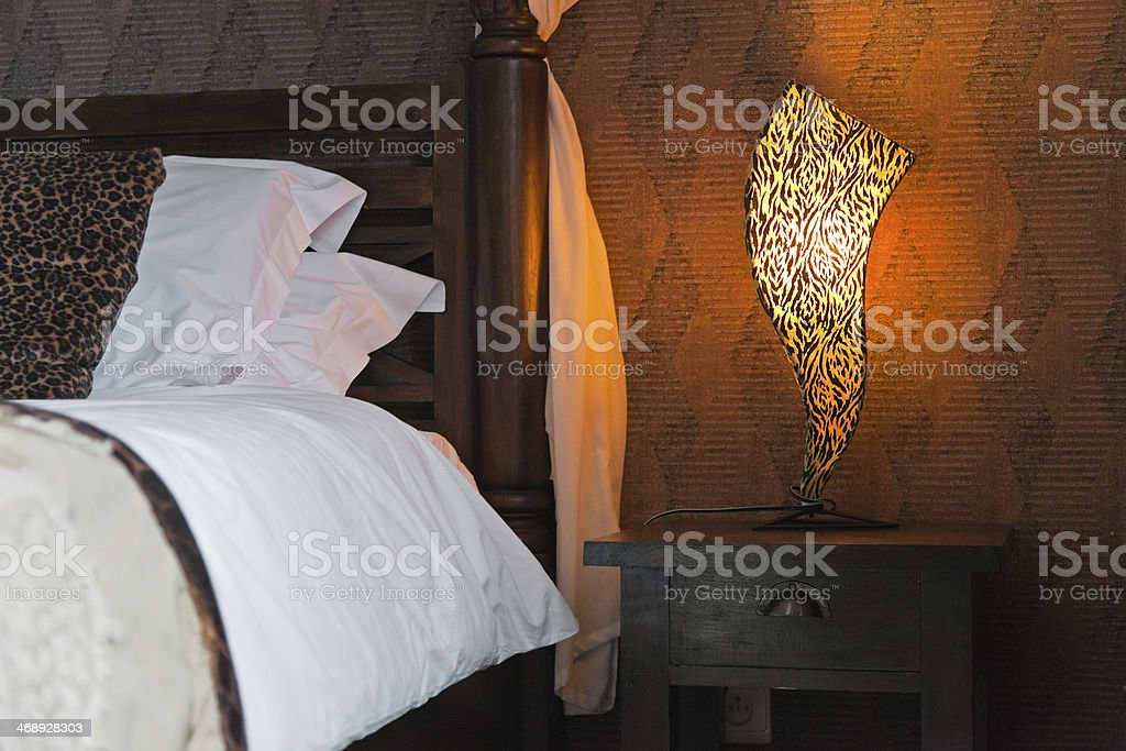 African style bedroom with bed lights. royalty-free stock photo