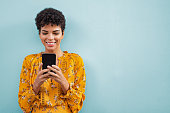 istock African stylish woman using smart phone 1134000432