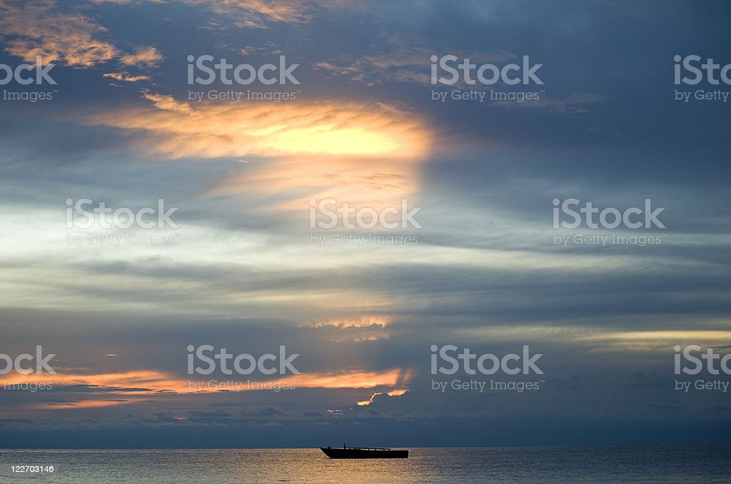 African sunset with boat on Lake Tanganyika stock photo