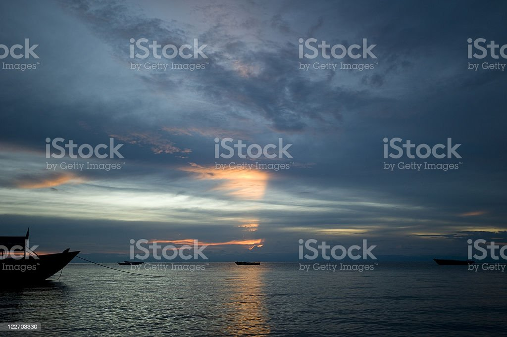 African sunset with boats on Lake Tanganyika stock photo