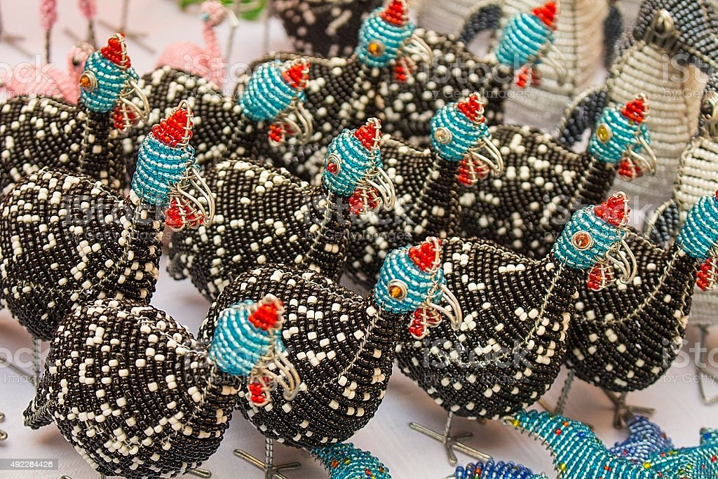 African traditional handmade colorful bead wire toys animal bird. stock photo