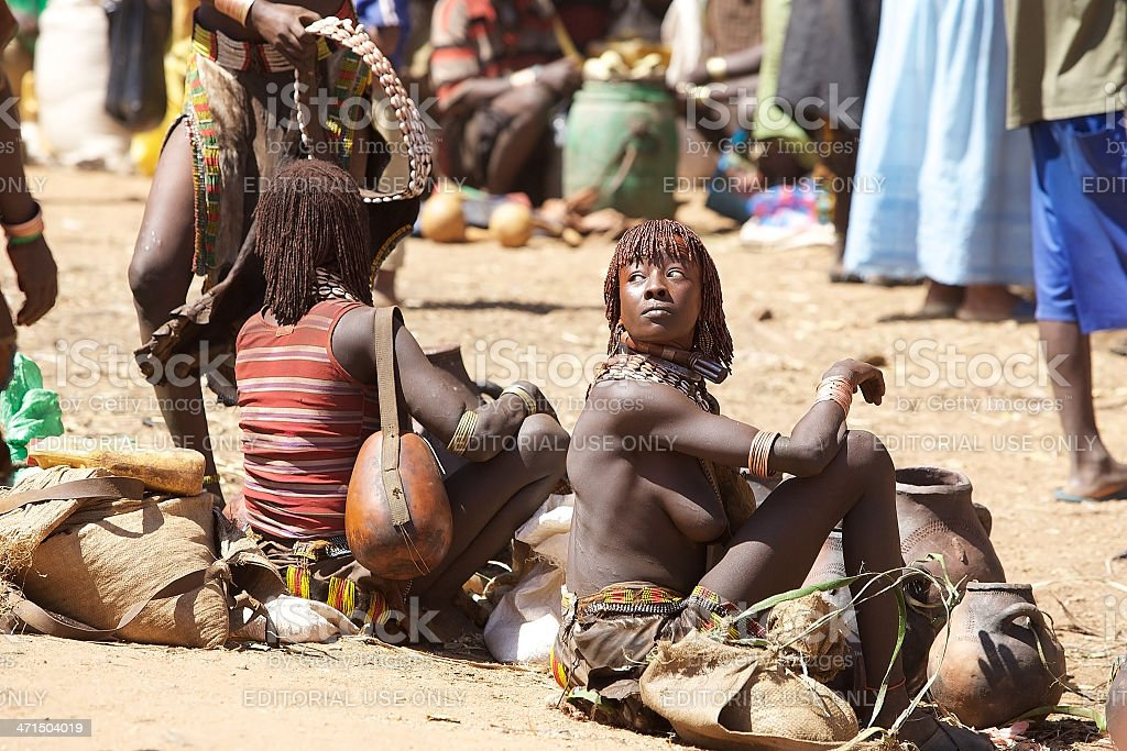 african women of the Hamer ethnic group are selling pottery at the...