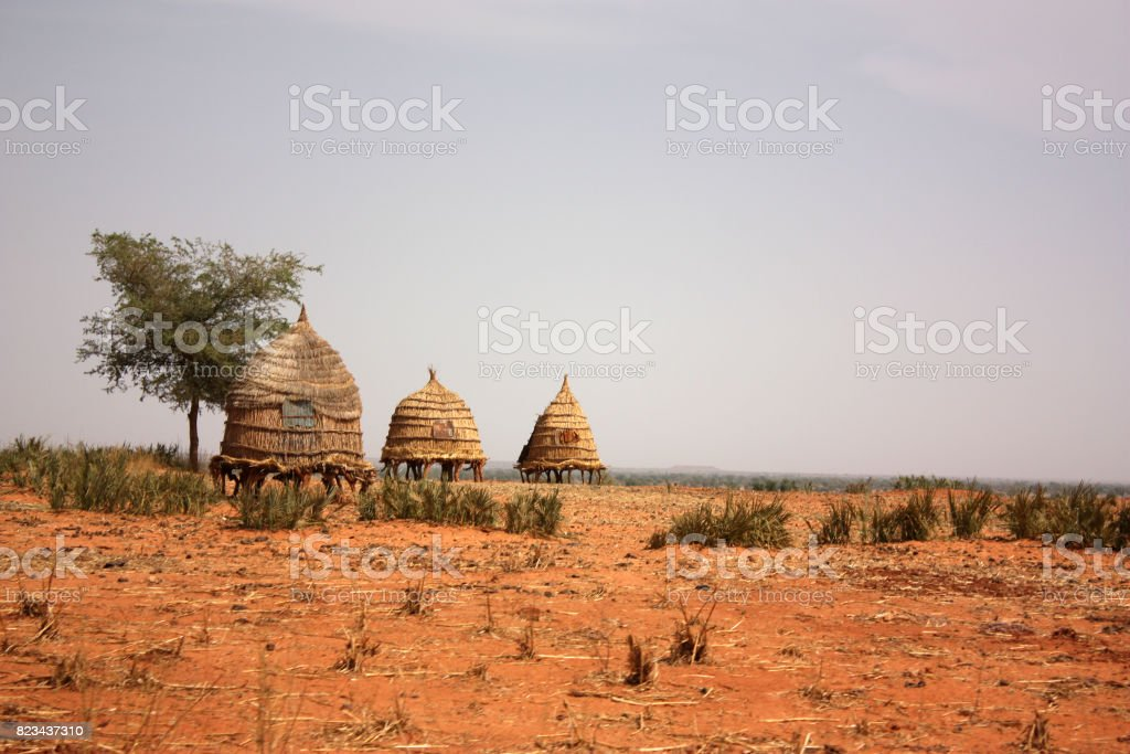 African village huts stock photo