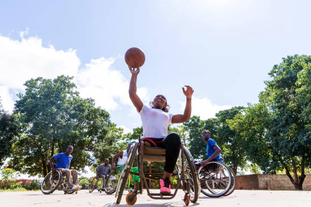 African Wheelchair Basketball Players on the Community Ground Playing a Friendly Match stock photo