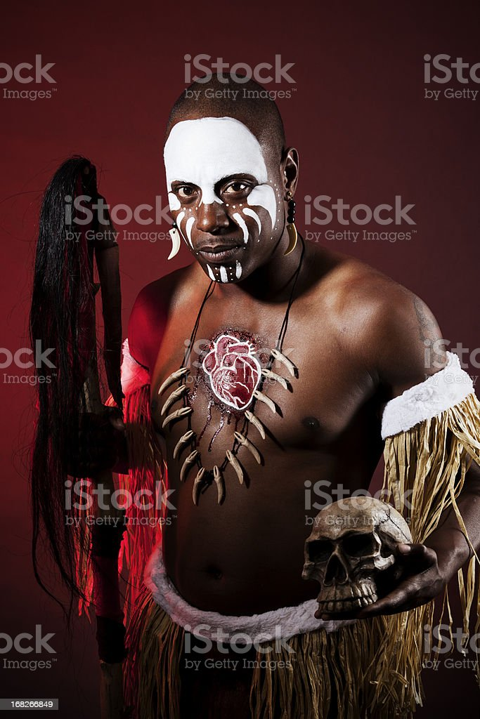 African witch doctor with bodypaint in dramatic light stock photo