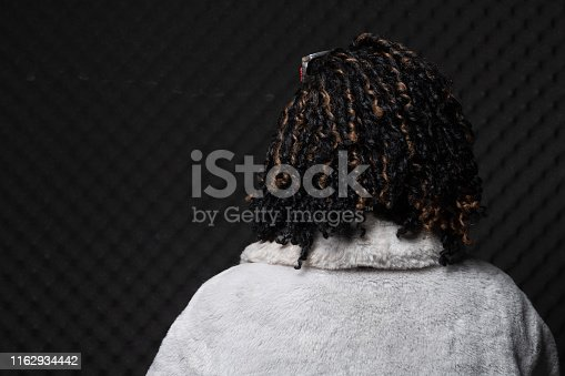 1049378188 istock photo African Woman Afro hair 1162934442