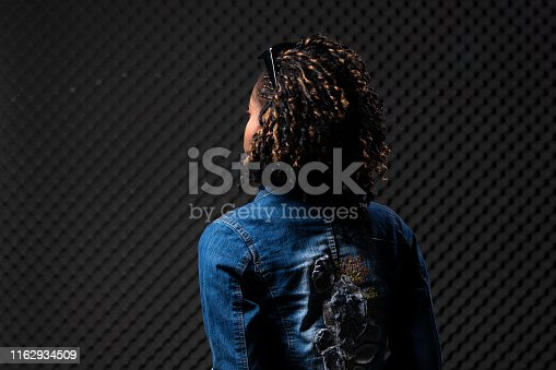 1049378188 istock photo African Woman Afro hair 1162934509