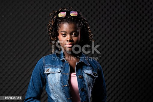1049378188 istock photo African Woman Afro hair 1162935234