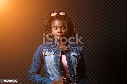 1049378188 istock photo African Woman Afro hair 1162935290