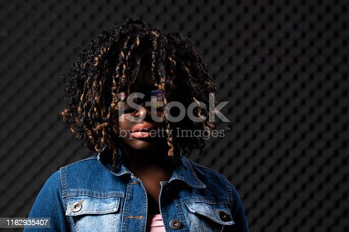 istock African Woman Afro hair 1162935407