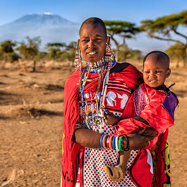 African woman carrying her baby, Kenya, East Africa stock photo
