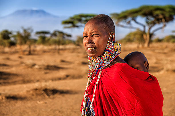 african woman carrying her baby, kenya, east africa - kenyan culture stock photos and pictures