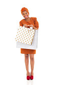 istock african woman carrying two shopping bags 480929125