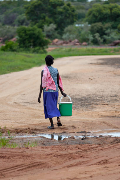 African woman carrying water