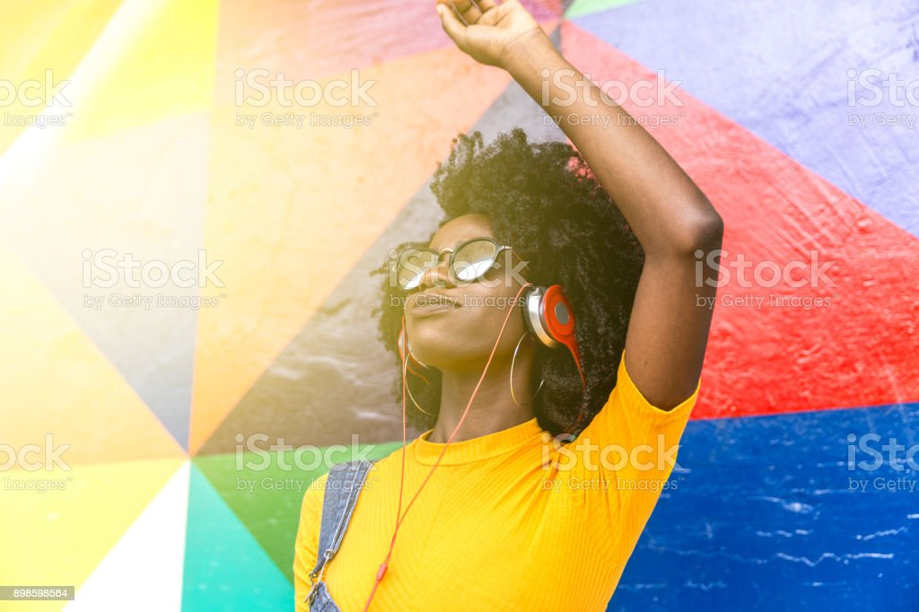 African woman dancing to her favorite song stock photo