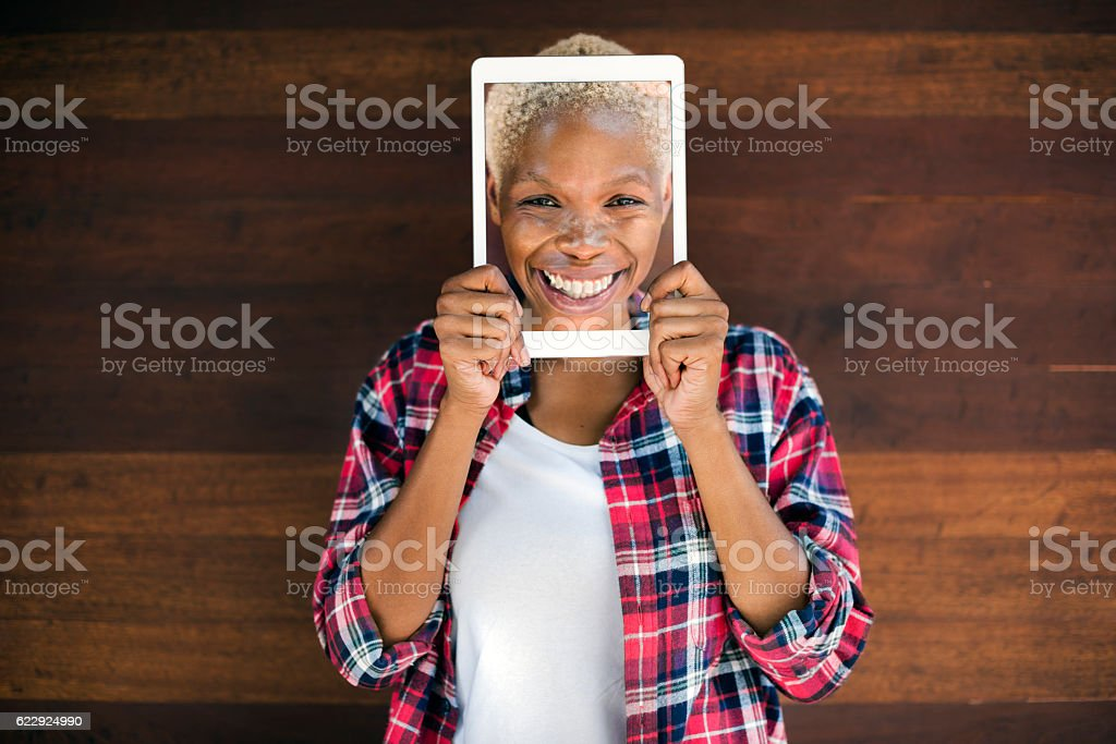 African Woman Digital Tablet Face Covered Smiling Technology Con stock photo