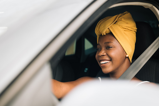 African woman driving a car