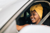 istock African woman driving a car 1295340788