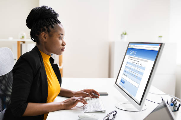 African Woman Filling Survey Poll Or Form stock photo