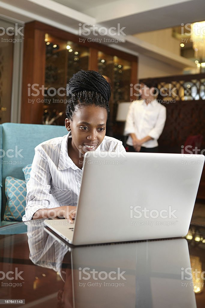 African woman having some free time during business meeting stock photo