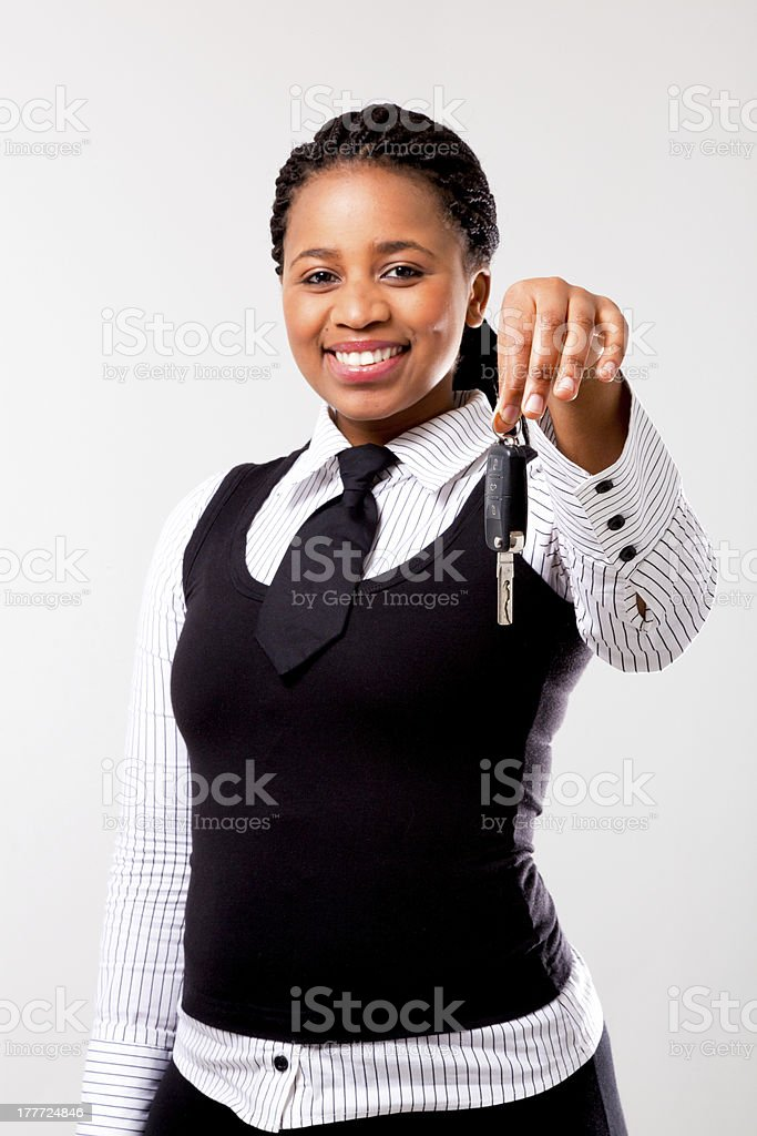 African woman holding car key stock photo