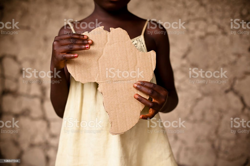 African woman holding shape of Africa royalty-free stock photo
