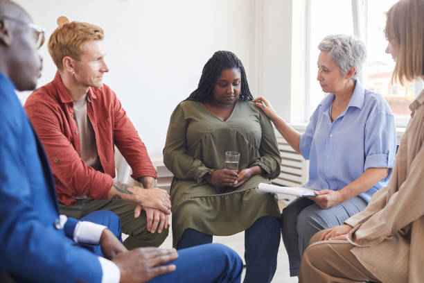 African Woman in Group Therapy Session stock photo