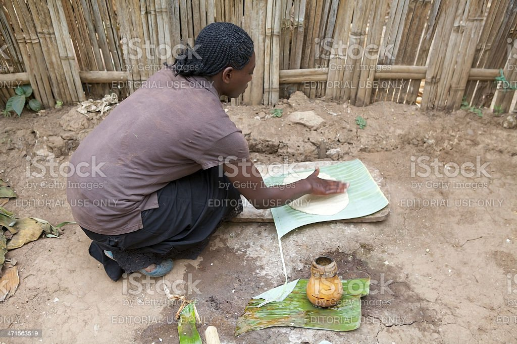 african woman is cooking stock photo