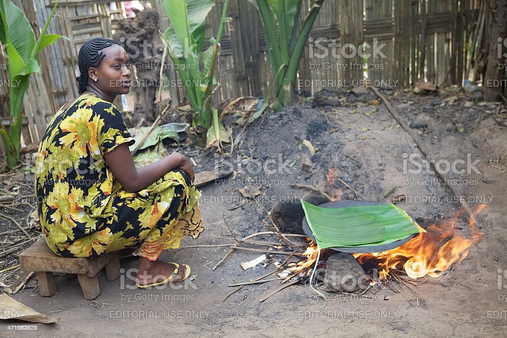 african woman is cooking royalty-free stock photo