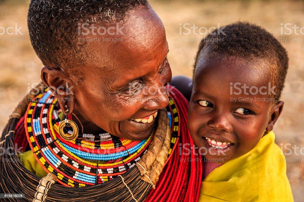 African woman kissing her baby, Kenya, East Africa – Foto