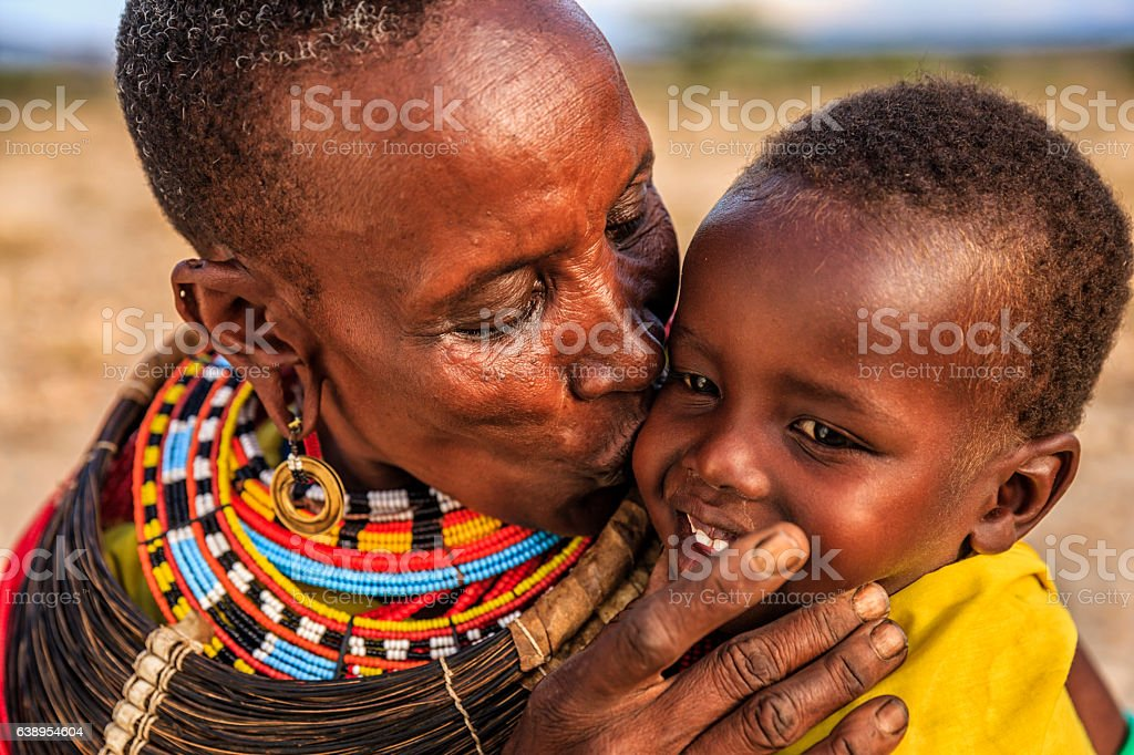 African woman kissing her baby, Kenya, East Africa stock photo