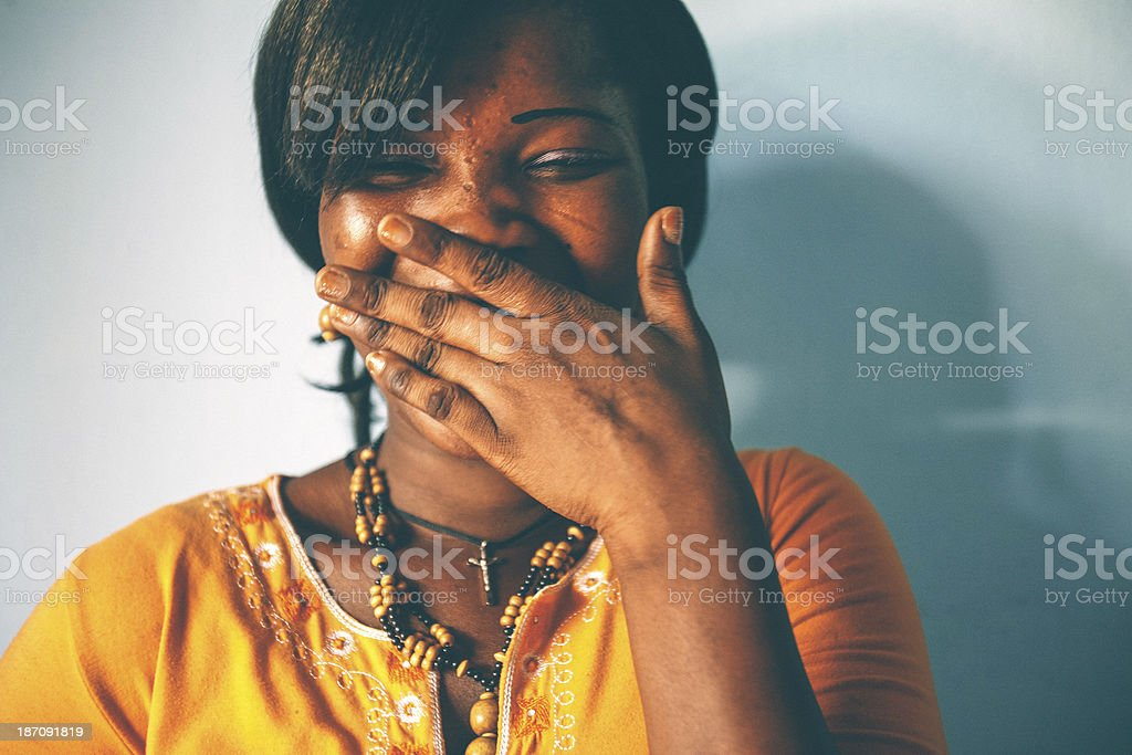 African woman laughing. stock photo