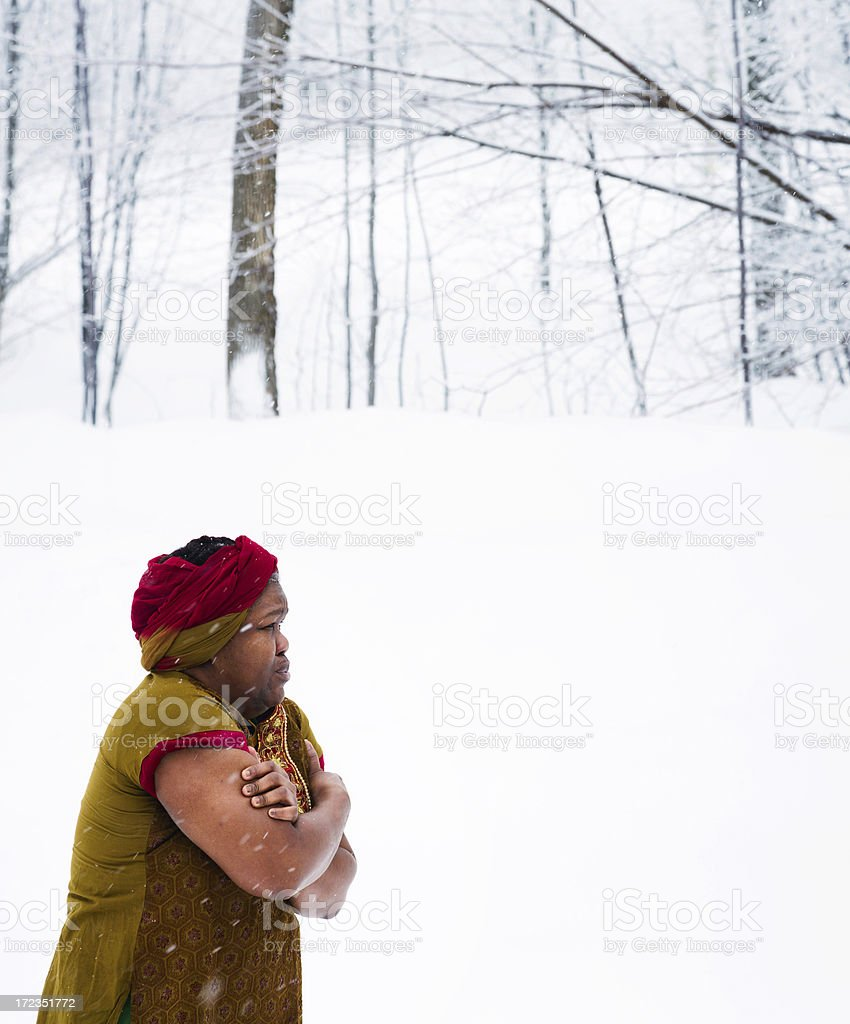 African woman lost in snowstorm royalty-free stock photo