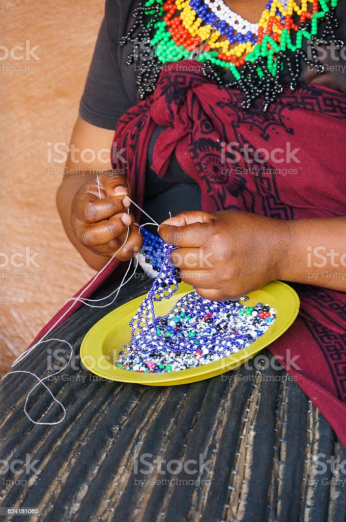 African woman making souvenirs for sell,South Africa. stock photo